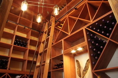 Ladder and lightning for custom wine cellars
