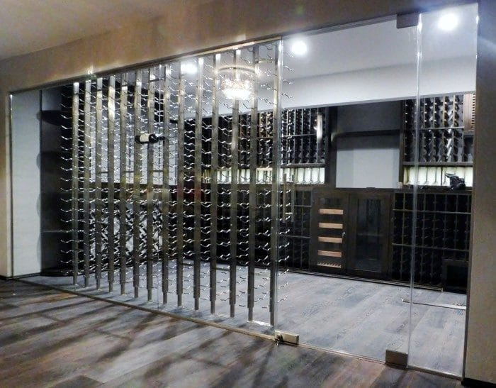 Contemporary Home Wine Cellar with Seamless Glass Door and Walls