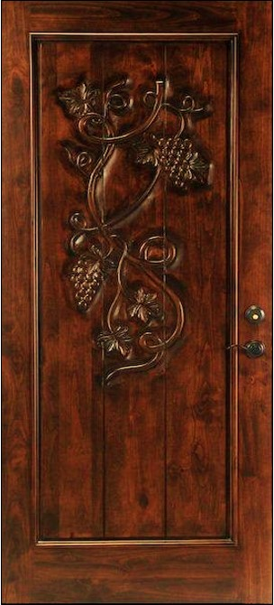 Solid Santa Barbara Style Alder Door with custom carving