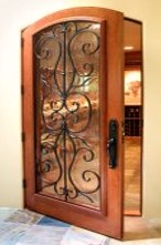 Stunning Tuscan Style Custom Wine Cellar with Iron detailing