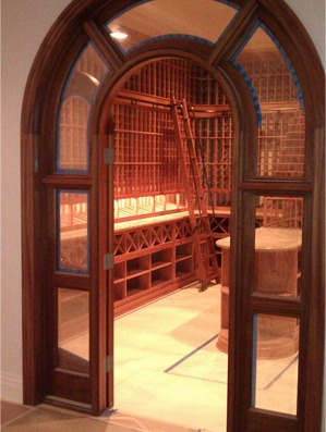 Custom wine cellar Los Angles California arched glass cellar door