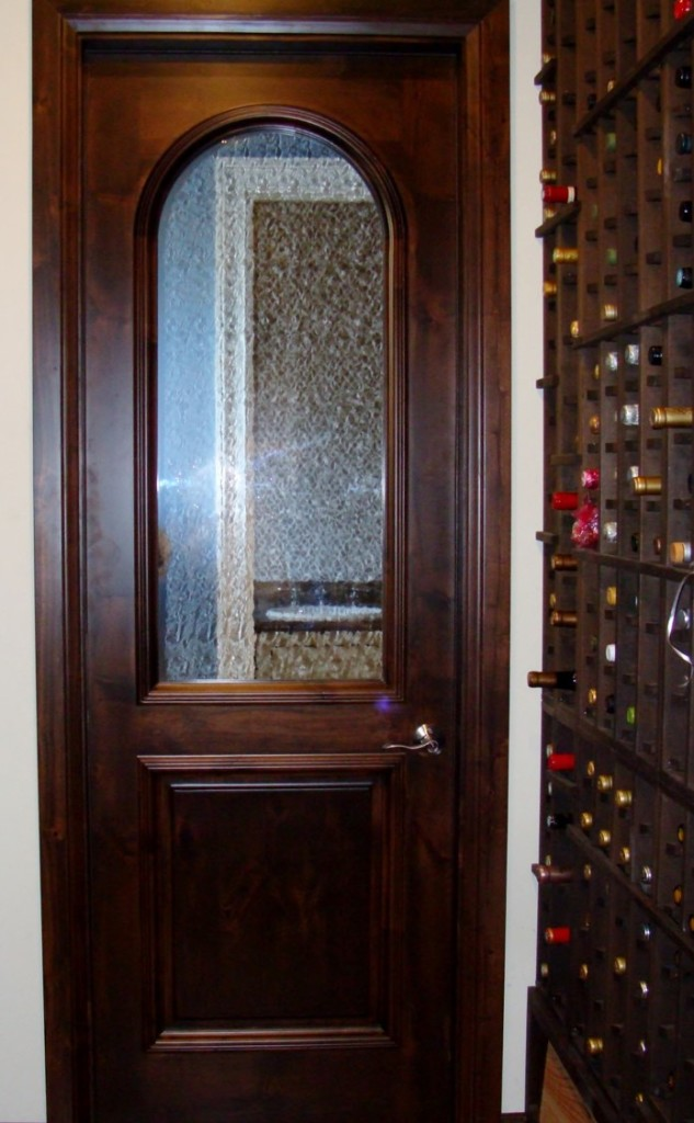 The door was custom designed specifically for this wine cellar