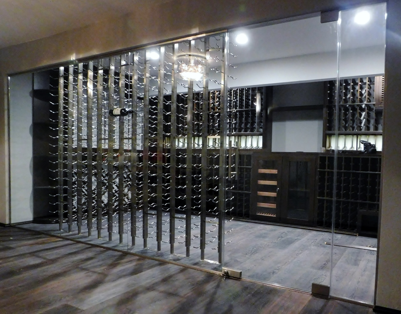 This design idea is now a 2,055 bottle wine cellar tasting and cigar room 1300p