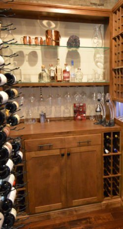 Glass was the third element needed to bring the wood and metal together and truly make the design of this custom wine cellar transitional!